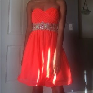 A pinkish/orangish prom dress.